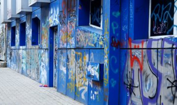 "ODESSA, UKRAINE - MARCH 3, 2016:urban street abstract art paintings on old blue abandoned building of old Odessa center district, so called ""Gutter"", South Ukraine"