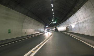 Light and projected shadows inside the Vedeggio-Cassarate road tunnel with lights,signs and traffic